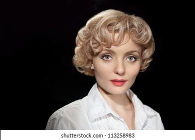 Portrait beautyful  blonde woman in retro style. Woman looks like  twin of Marylin Monroe