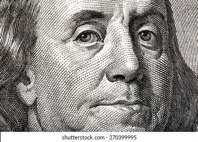 Portrait of Ben Franklin on the US $100 dollar bill in macro.