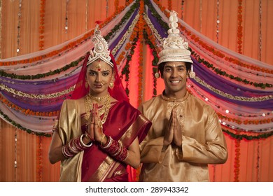 Portrait of Bengali bride and groom greeting