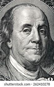 Portrait of Benjamin Franklin on the hundred dollar bill.