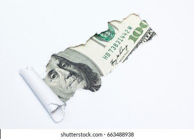 Portrait of Benjamin Franklin on a hundred dollar bill in the gap (hole) of a white background. Dirty money, tax evasion.