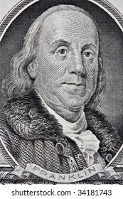 Portrait of Benjamin Franklin from the one hundred dollar bill.  This is an old style bill.