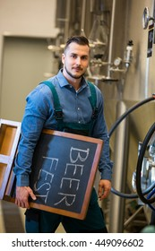 Portrait of bewer holding placard at bewery