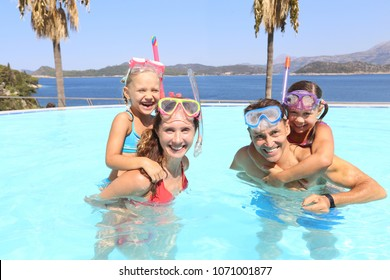 Portrait of big family  swimming in  pool on sea resort