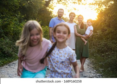 Portrait of the big happy family. Parents with children in countryside outdoors