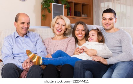 Portrait of big smiling multigenerational family on sofa at home