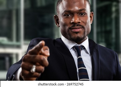 Portrait of a black businessman pointing his finger to you