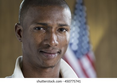 Portrait of a black man in front of an American flag