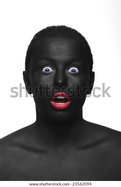 portrait of black painted woman with red lips and blue eyes