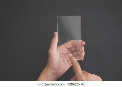 A portrait of a blank glass square on black background, futuristic transparent smart phone mock up