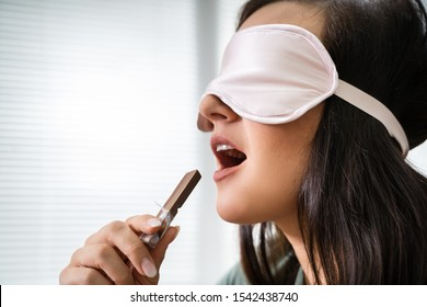 Portrait Of Blindfolded Young Woman Testing Food