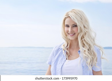 Portrait of blond  beautiful young woman on sailing boat.