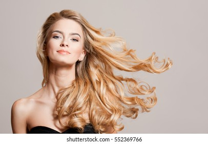 Portrait of blond beauty with amazing long healthy hair.