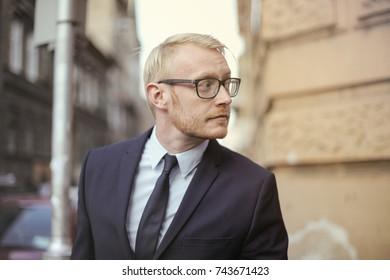 Portrait of blond businessman in elegant clothes