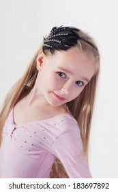Portrait in blond girl with long hair in studio