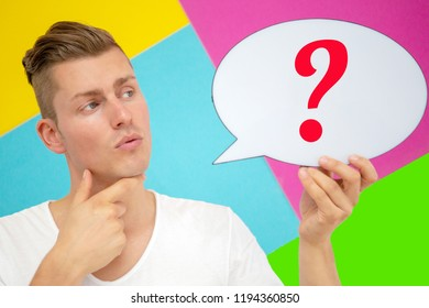 portrait of blond man holding a speech bubble with a question mark