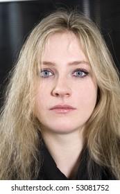 portrait of blond serious teen girl