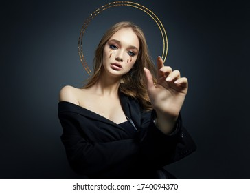 Portrait of blond sexy woman with long hair halo nimbus over her head on black background. Perfect girl with nimb, beautiful eyes, nice clean skin, beautiful natural makeup, long hair, saint girl