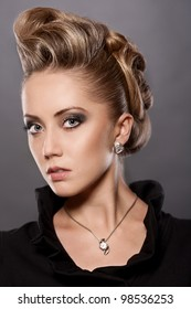 Portrait of  blond woman with fashion hairstyle