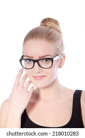 Portrait of Blond Woman with Hair in Bun Wearing Eyeglasses and Touching Face in Studio