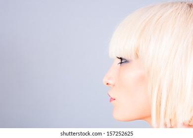 portrait of a blond woman. profile