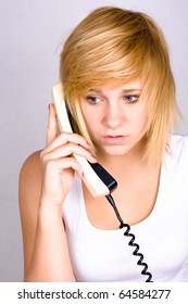 portrait of blond woman with retro telephone