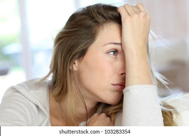 Portrait of blond woman with sad look