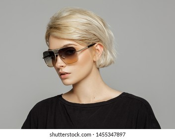 Portrait of blond woman in sunglasses