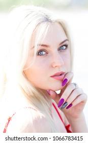 Portrait of a blonde in bright sunlight