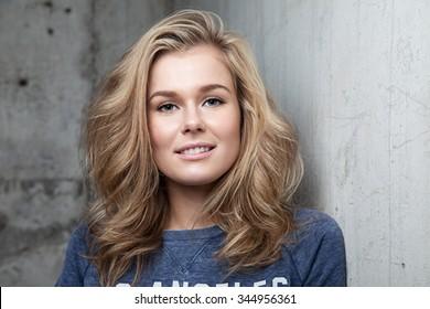 Portrait of a blonde girl with bushy hair