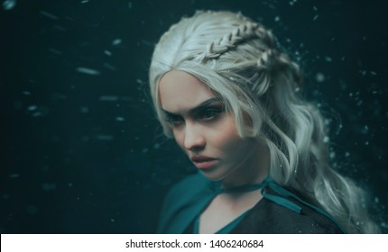 Portrait of a blonde girl close up. Background dark with flying snow, ash. White hair with creative braiding. Emotions of anger, and madness. The  queen Daenerys Targaryenon. She tells dracarys