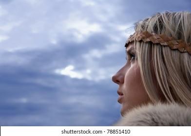 Portrait of the blonde girl in the Scandinavian suit
