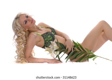 Portrait of the blonde with a long curly hair with lily flower