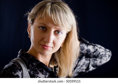 Portrait of the blonde on a black background