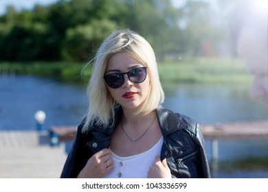 portrait of a blonde in sunglasses and red lips. summer
