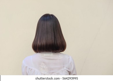 Portrait Bob hair style and Medium dark brown hair woman on white wall background.
