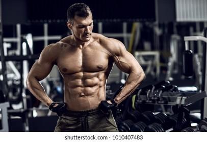 portrait bodybuilder man in gym, horizontal photo