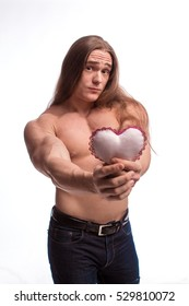 Portrait of a bodybuilder man with long hair with a gift in hand on white background