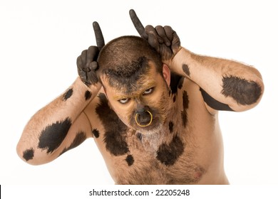 Portrait of bodypainted man imitating bull by pointing forefingers upwards by his head