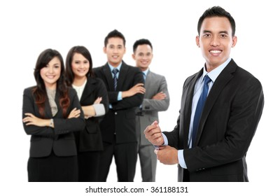 portrait of boss standing in front of his team, leading to success