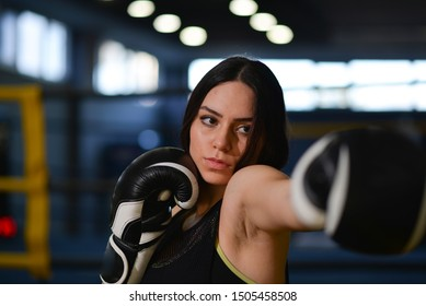 portrait of boxer girl in the boxing ring