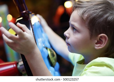 Portrait of a boy at amusement park