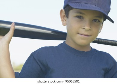 Portrait of boy with baseball bat