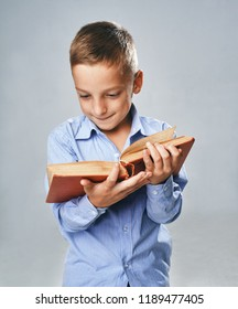 a portrait of a boy with a big book