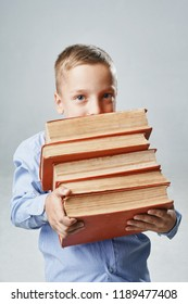 a portrait of a boy with big books