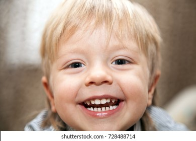 Portrait of a boy with a big smile.