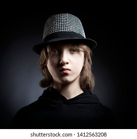 Portrait of a Boy with Blond Hair in Hat and Black Top.