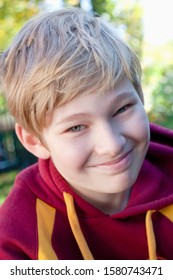 Portrait of a Boy with Blond Hair Outdoors