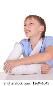 portrait of boy with a broken arm