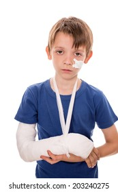 portrait of boy with a broken arm, isolated over white
